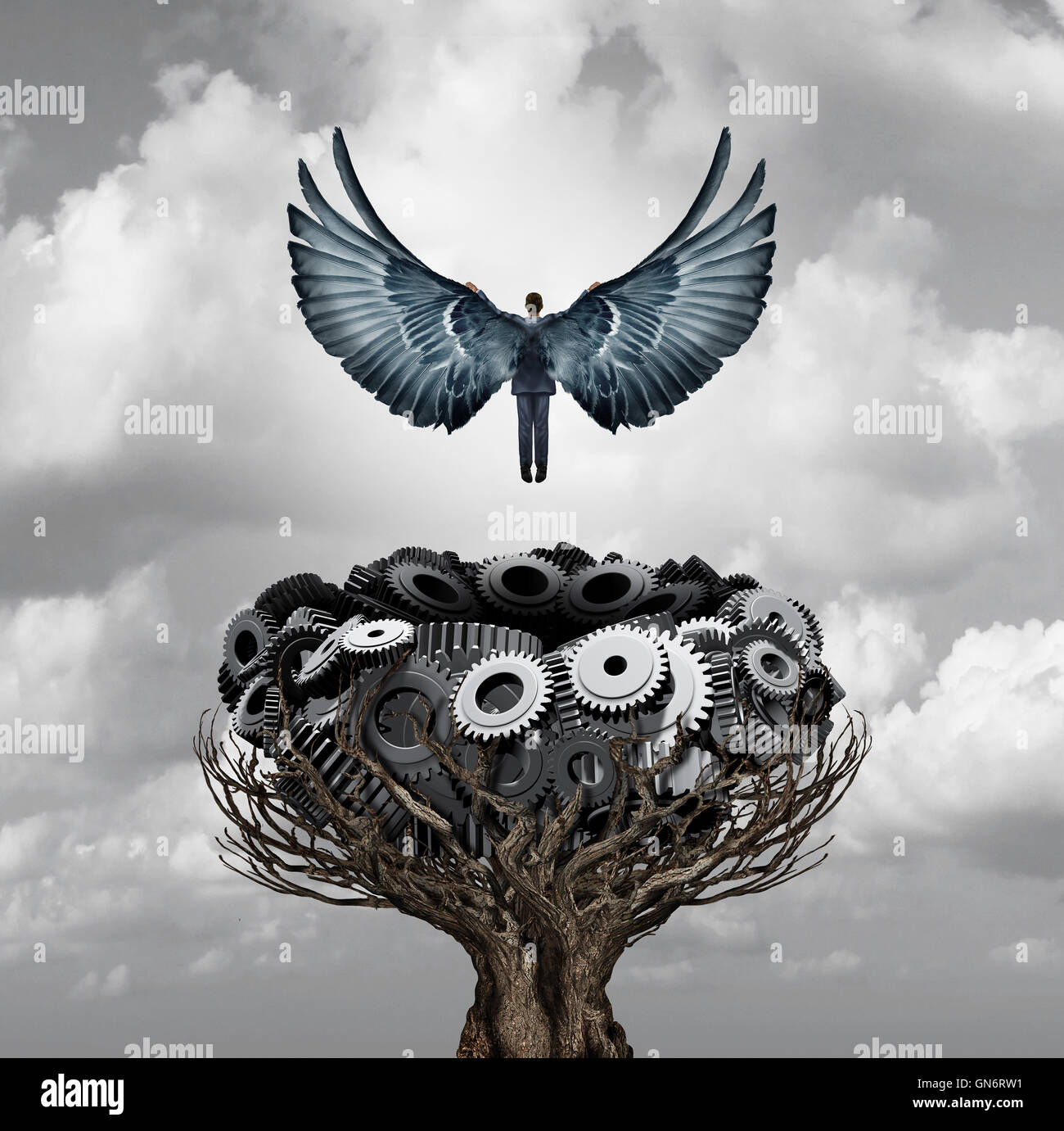 Businessman career start as a person with open wings flying up away from a nest made of gears and cogwheels as a - Stock Image