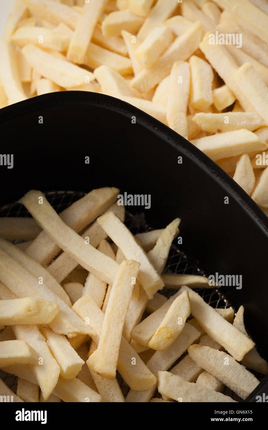 freeze fries french close up flat lay still life junk fastfood - Stock Image