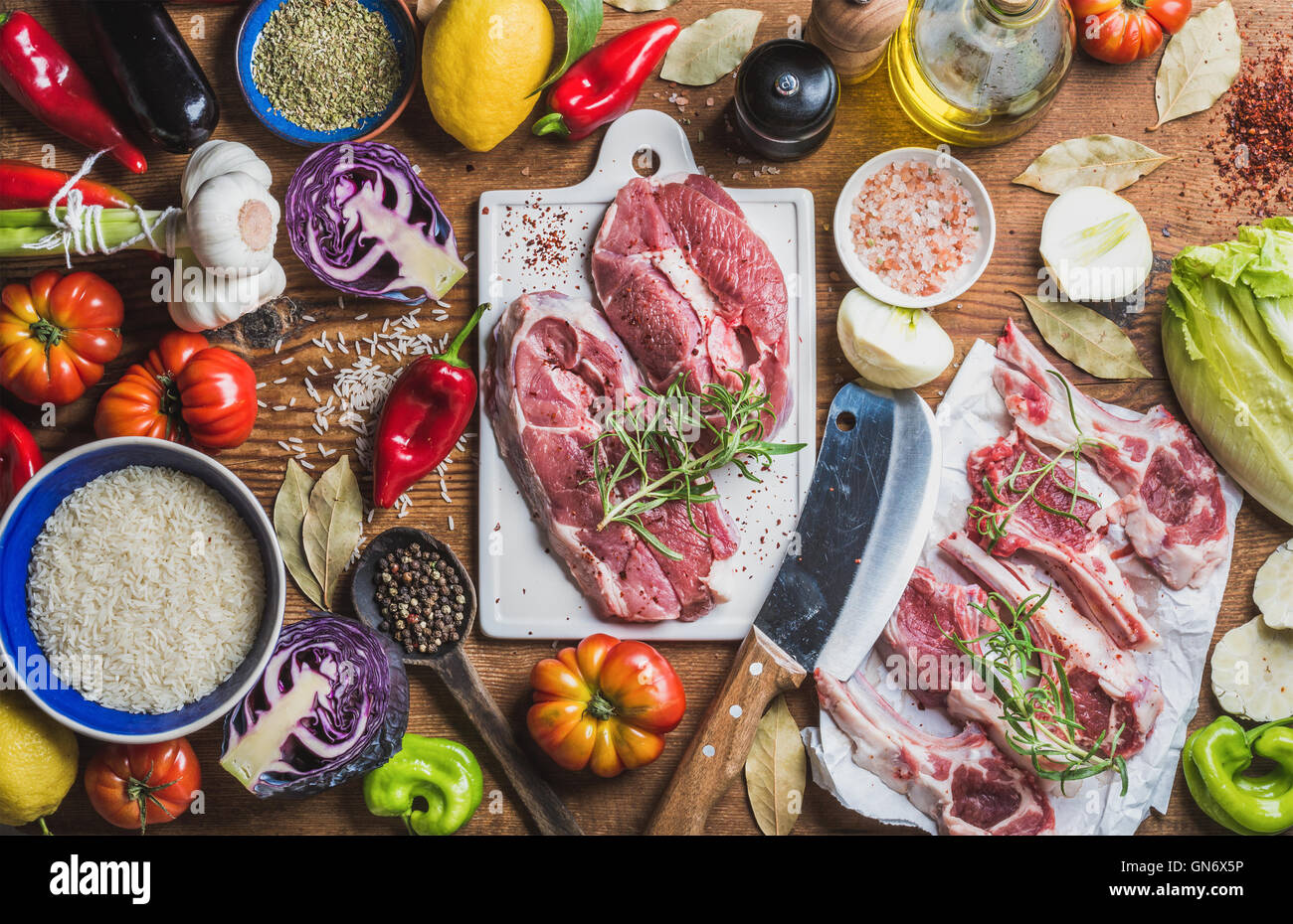 Raw uncooked lamb meat assortment, rice, oil, spices and vegetables - Stock Image