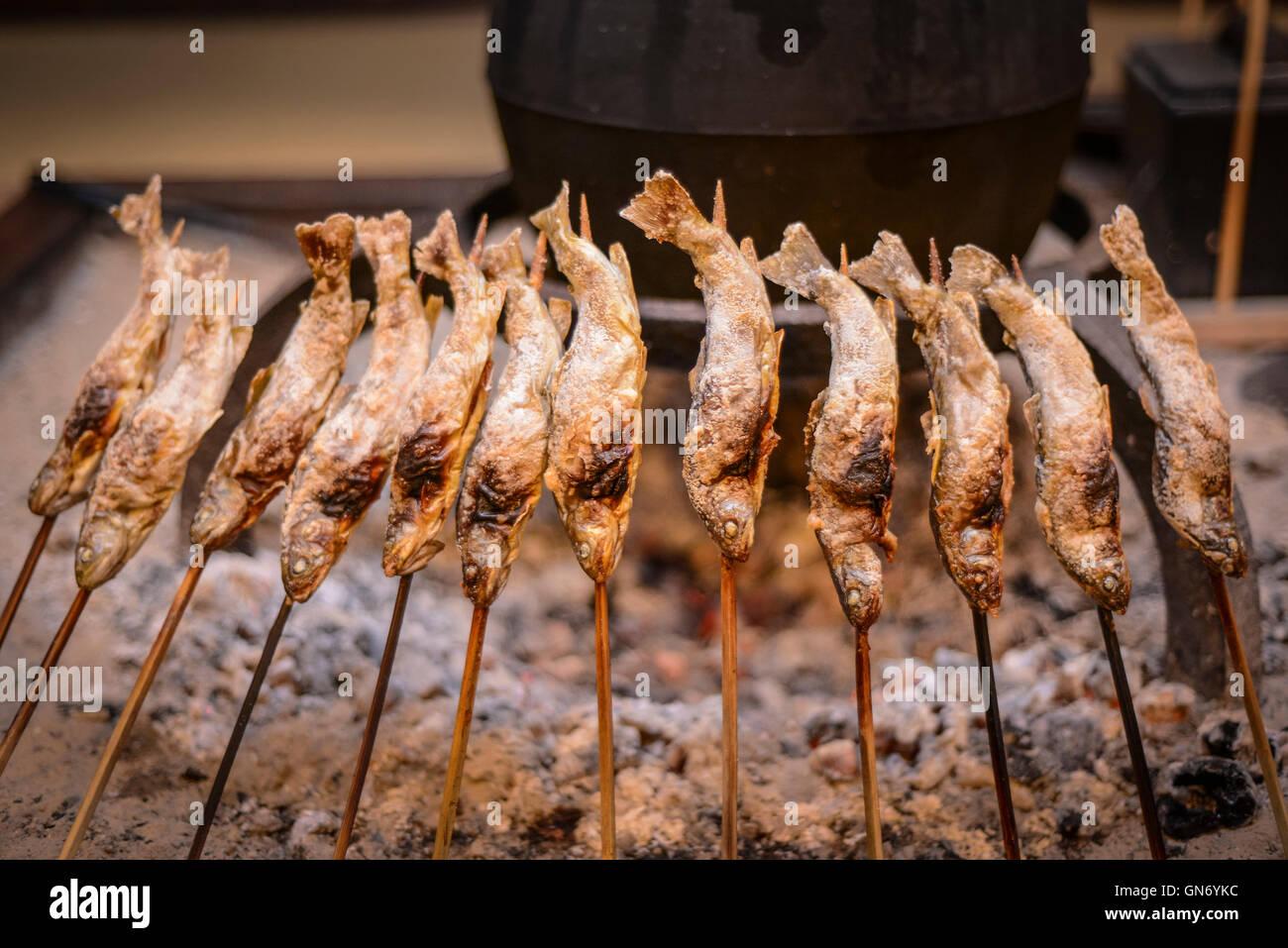 Fish Roasting, Shirakawa, Japan - Stock Image