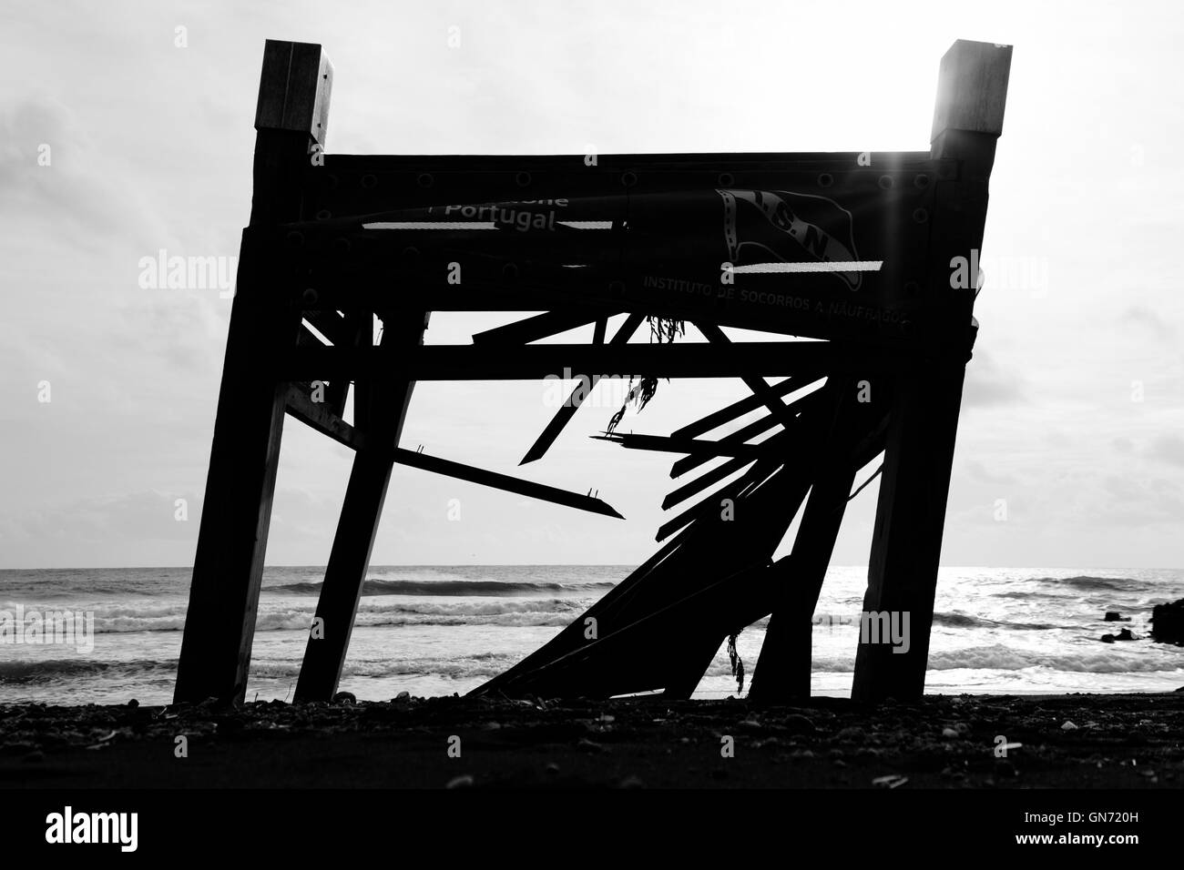 Destroyed lifeguard place at the beach. Black and white and centered - Stock Image