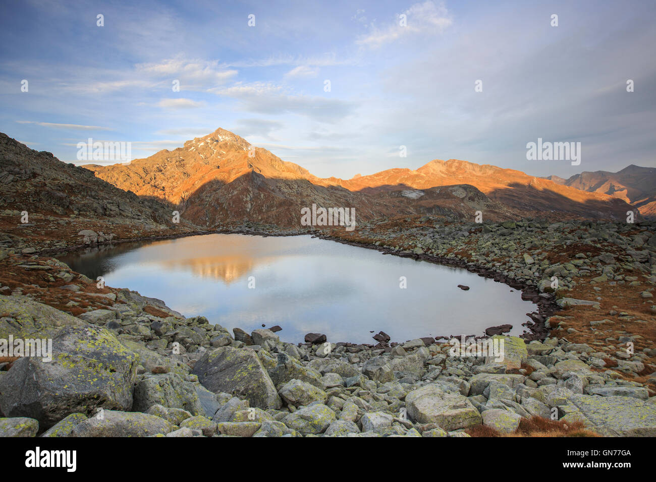 Peak Tambò reflected in Lake Bergsee at dawn Chiavenna Valley Spluga Valley Switzerland Europe - Stock Image