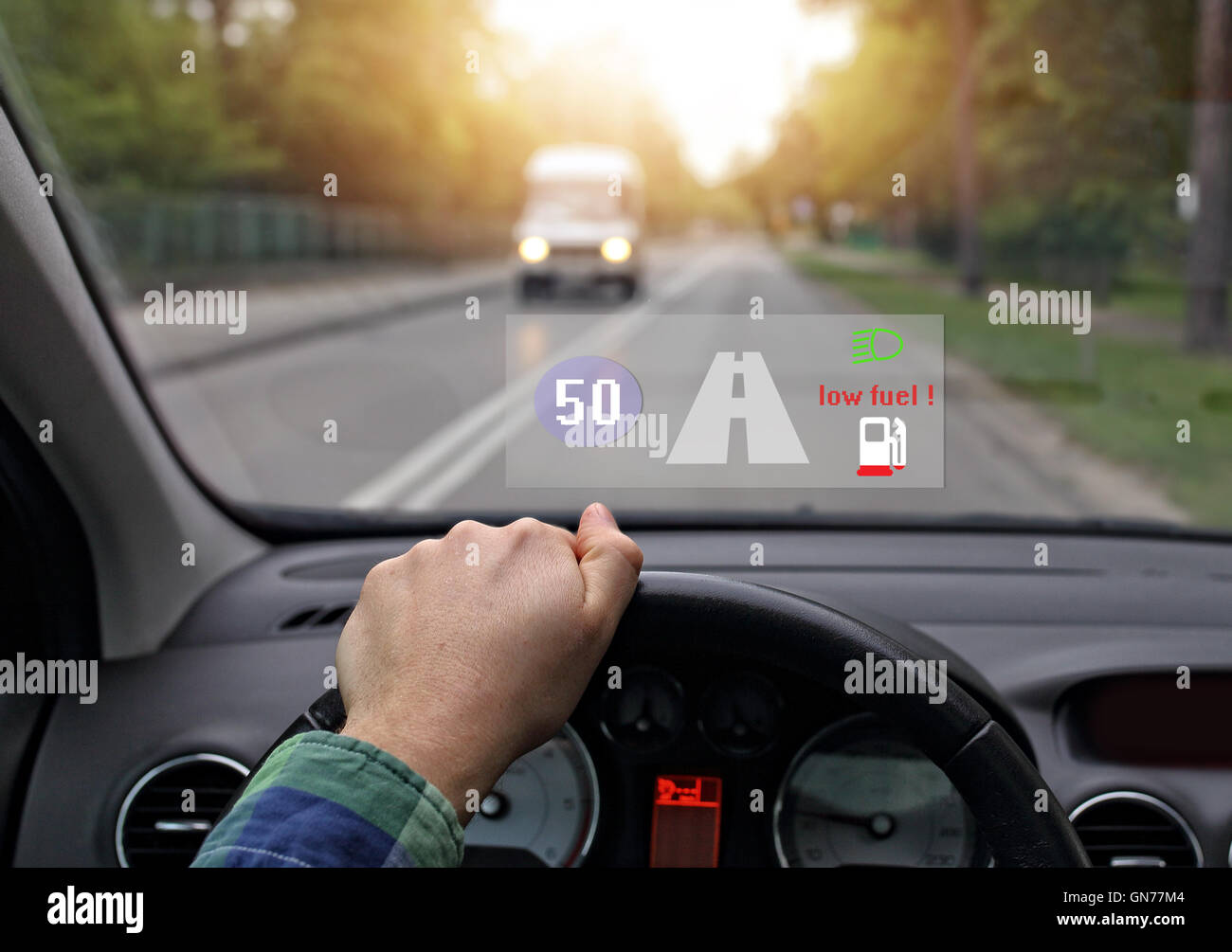 car equipped with head up the system shows little fuel - Stock Image
