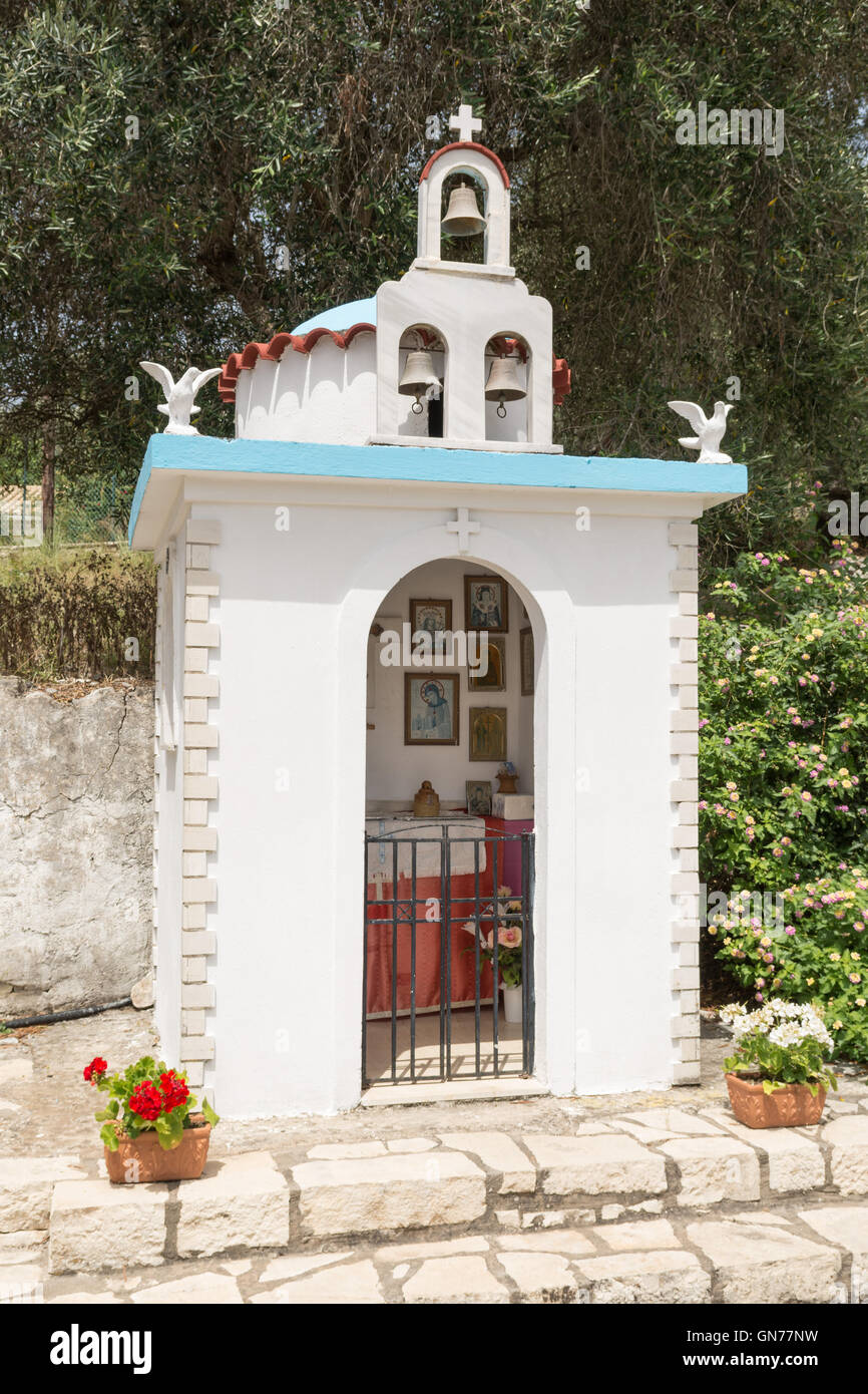 roadside greek orthodox shrine near Loggos on the tiny Greek island of Paxos, Greece, Europe (for interior see image - Stock Image
