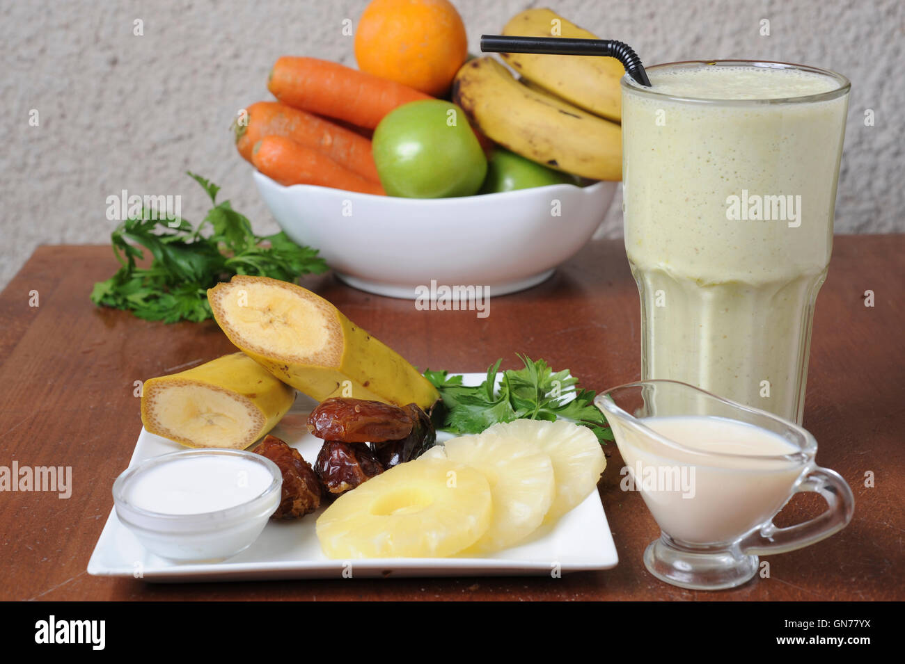 Organic Health Food meal. Fruit, vegetables and a shake drink - Stock Image