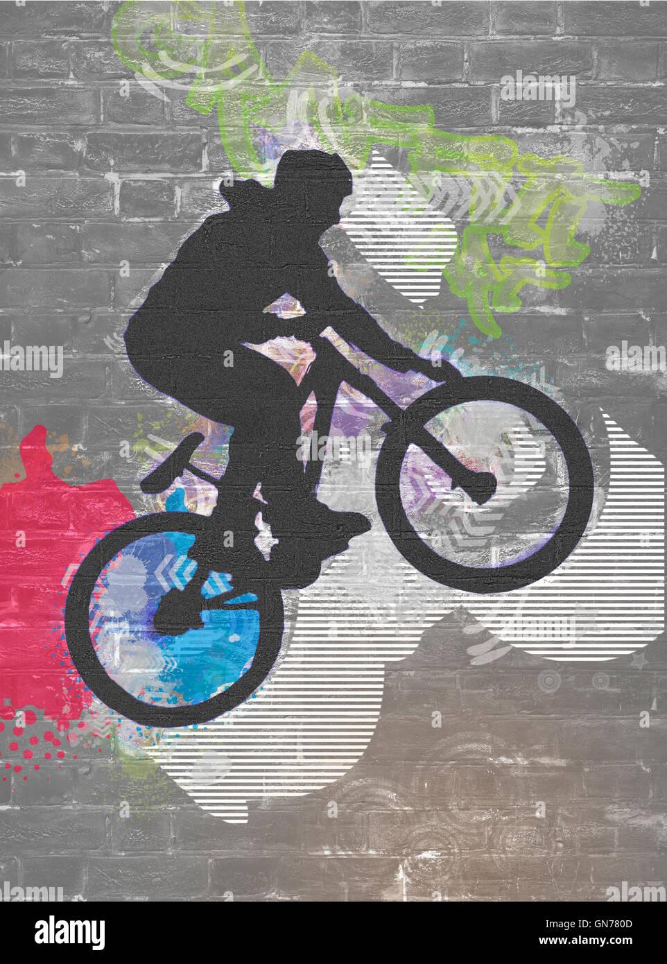 wall graffiti image of a bicycle stunt Stock Photo