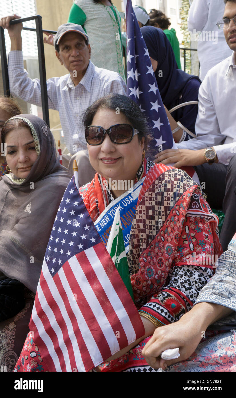 A Pakistani woman with an American flag in a float at the 2016 Pakistan Day Parade in New York City - Stock Image