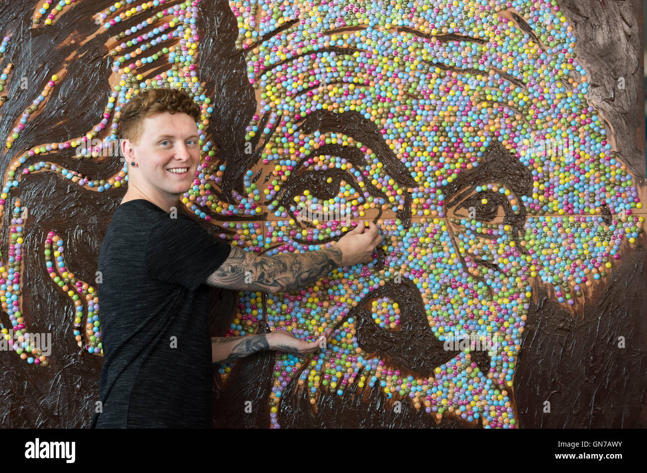 Cardiff artist Nathan Wyburn who created a portrait of Albert Einstein using Smarties. - Stock Image