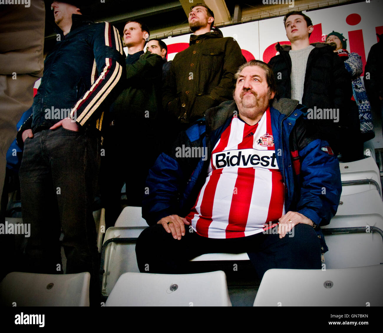 A Sunderland fan watches his team play at Swansea City - Stock Image