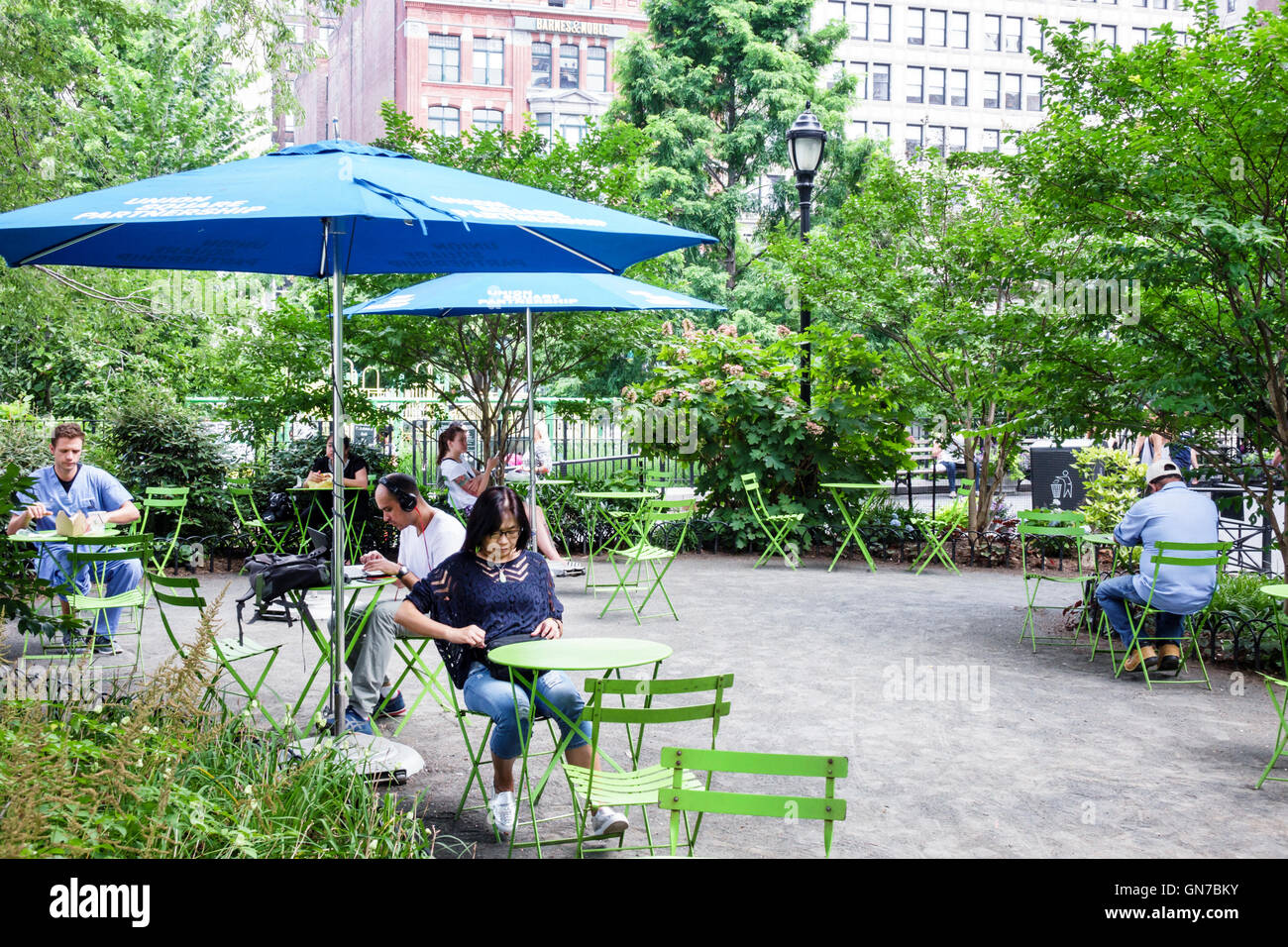 Manhattan New York City NYC NY Midtown Union Square Park public park outdoor seating green space vegetation table Stock Photo