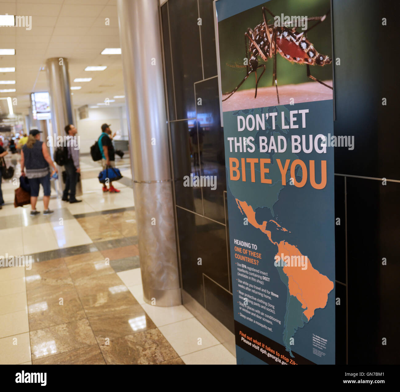 Sign in airport (Atlanta) warning travelers of the Aedes aegypti mosquito and Zika virus - Stock Image