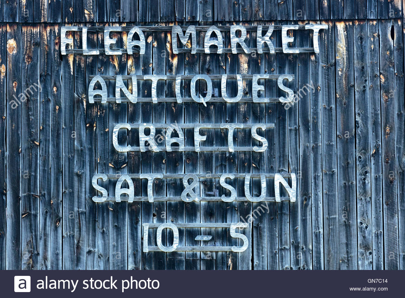 Sign on side of barn in Northumberland County in Southern Ontario Canada. Flea Market Antiques crafts barn jumble - Stock Image