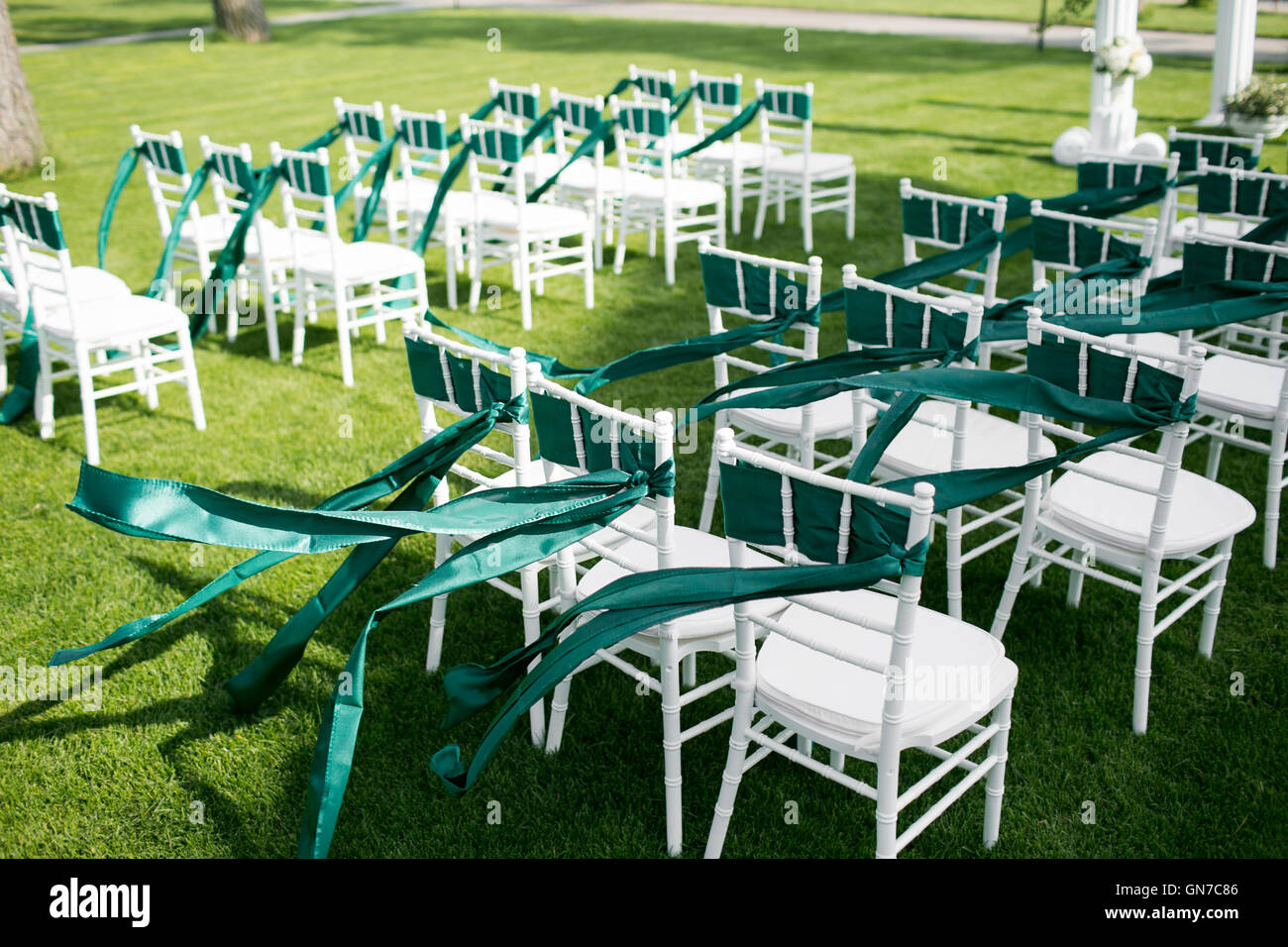 White Wedding Chairs With Green Ribbon Outdoors Stock Photo Alamy