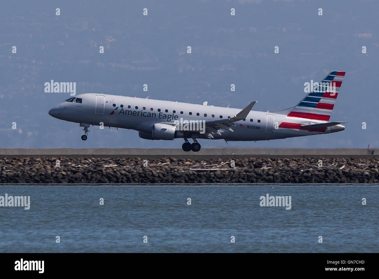 American Eagle Embraer ERJ 170-200 LR (N210NN) lands at San Francisco International Airport (SFO), Millbrae, California, - Stock Image