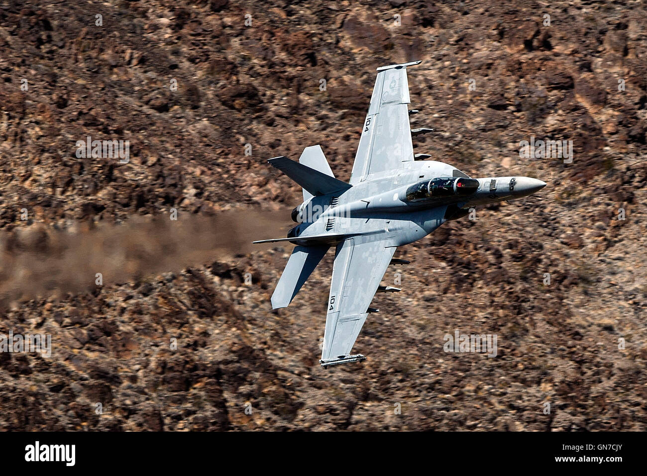 "US Navy Boeing F/A-18F Super Hornet NH-104 (SN 166877) from VFA-154 the ""Black Knights"" flies through the Jedi Transition, R-2508 complex, Star Wars Canyon / Rainbow Canyon, Death Valley National Park, California, United States of America. Stock Photo"