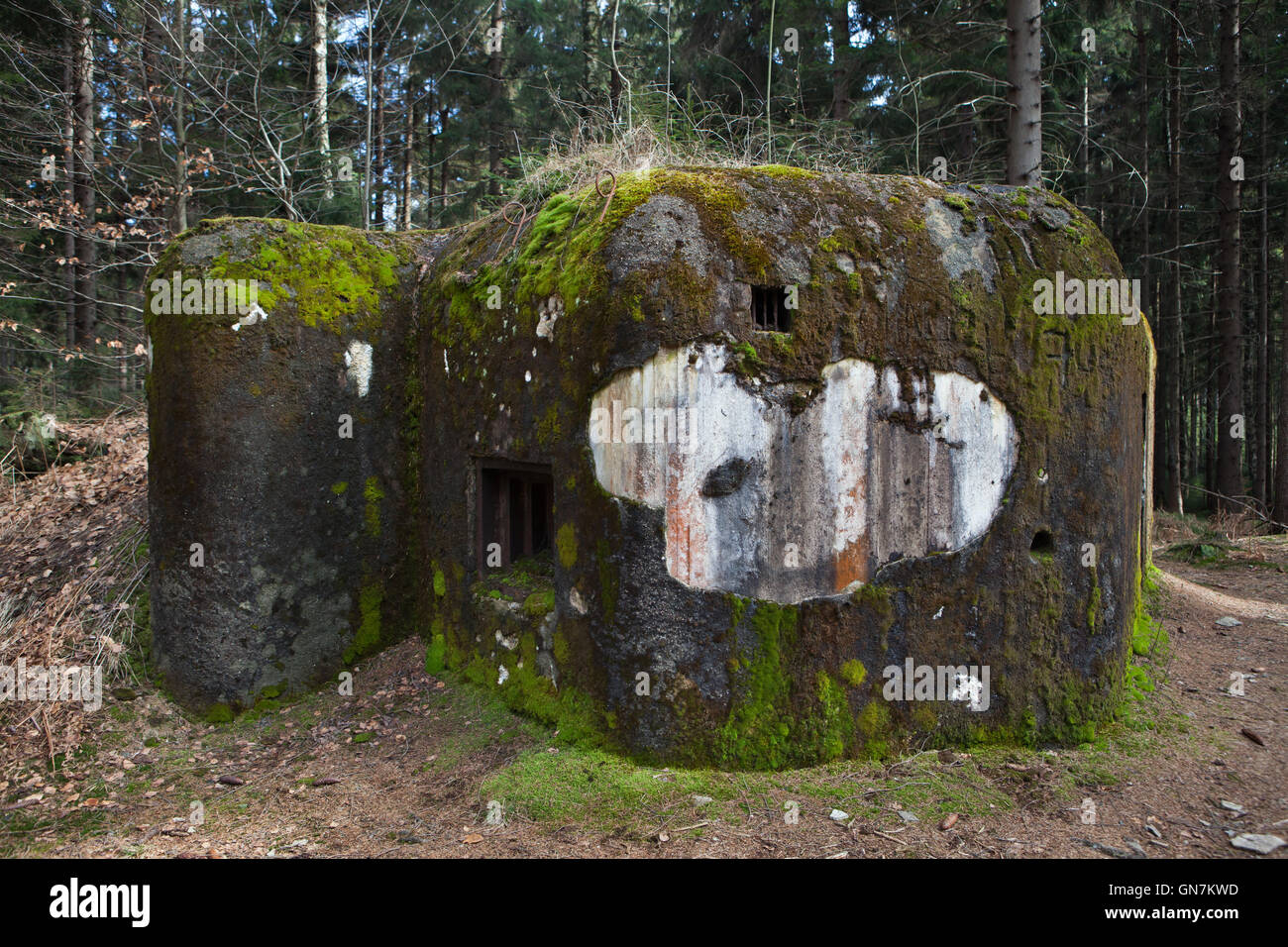 Abandoned pillbox model 37 once used to be a part of the Czechoslovak border fortifications located on the road Stock Photo