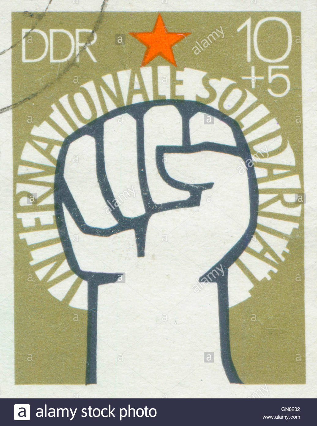 171e GERMANY - CIRCA 1972: A stamp printed in East Germany, showing of International Solidarity of Communists, circa - Stock Image