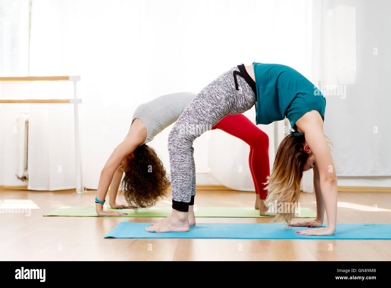 Two Young Girls Doing Back Bend Pose In Yoga Class Stock Photo Alamy