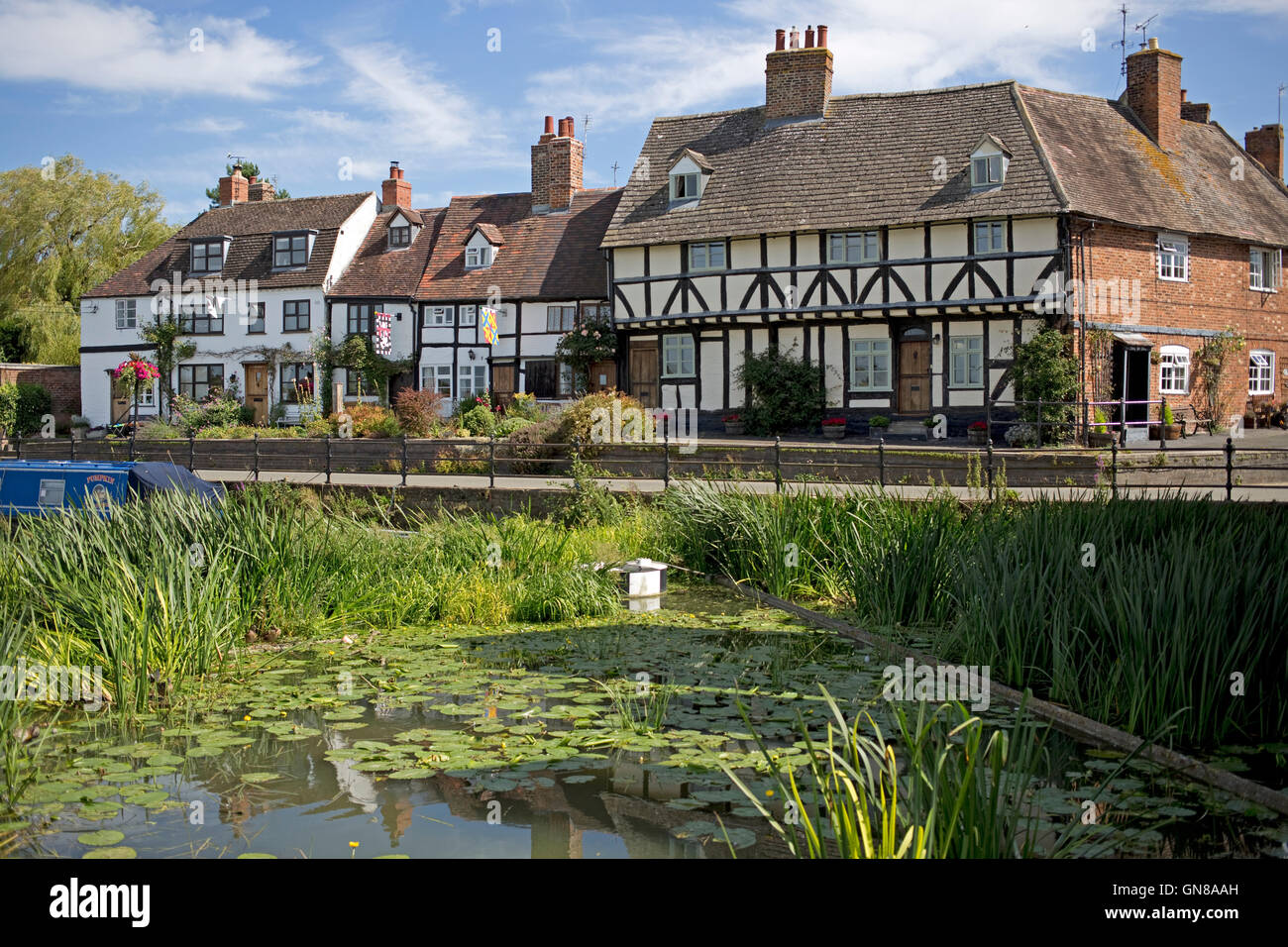 16th century black and white half timbered riverside cottages Mill Street Tewkesbury UK - Stock Image