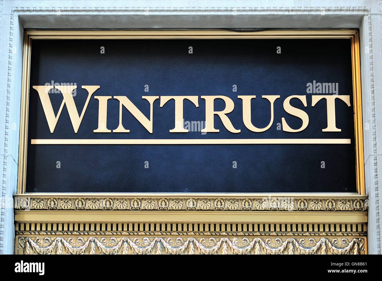 A Wintrust Bank sign on a building in Chicago's financial district is symbolic of the city's major role - Stock Image