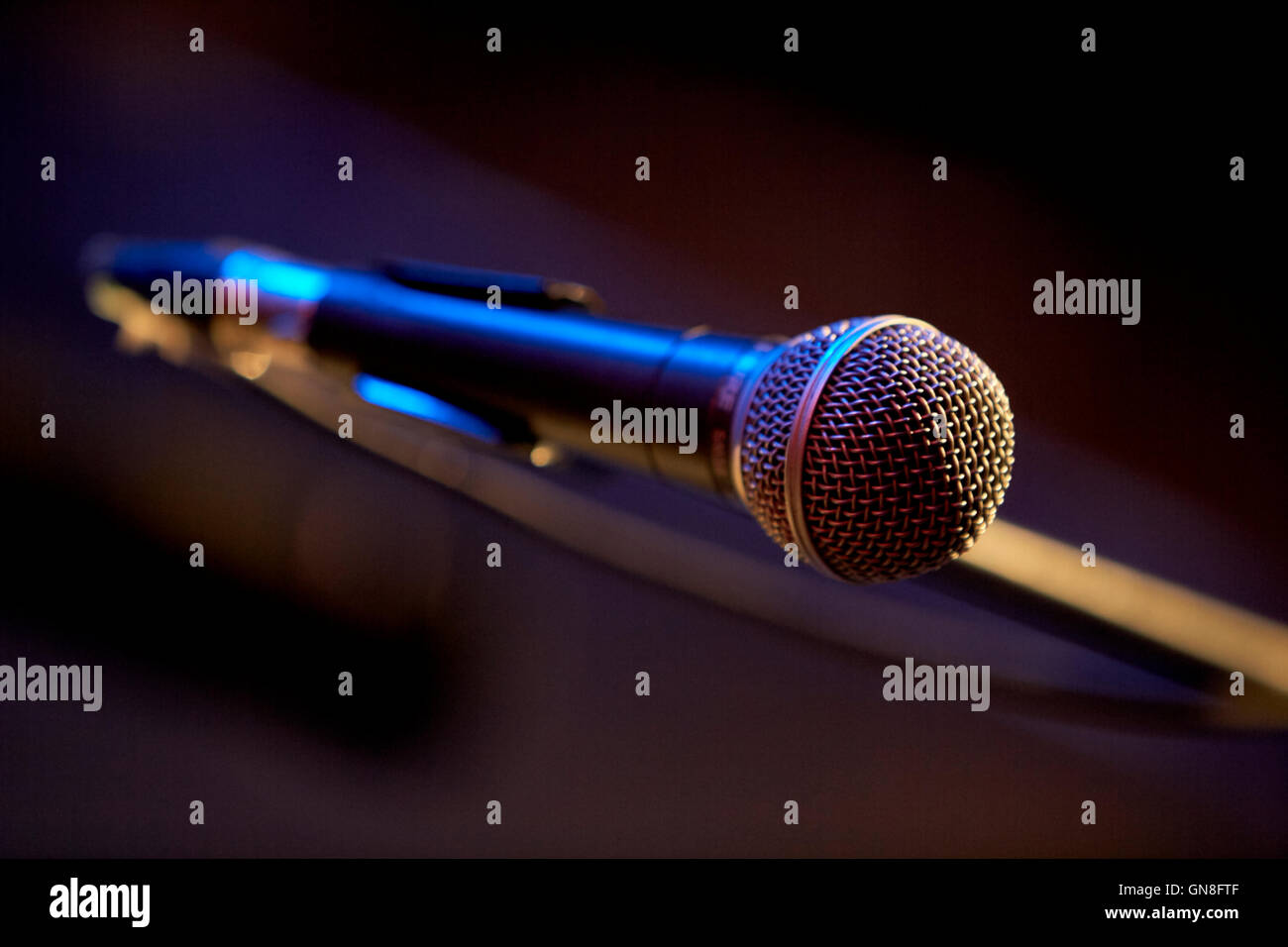 shure microphone on boom stand wired on stage in a theatre - Stock Image