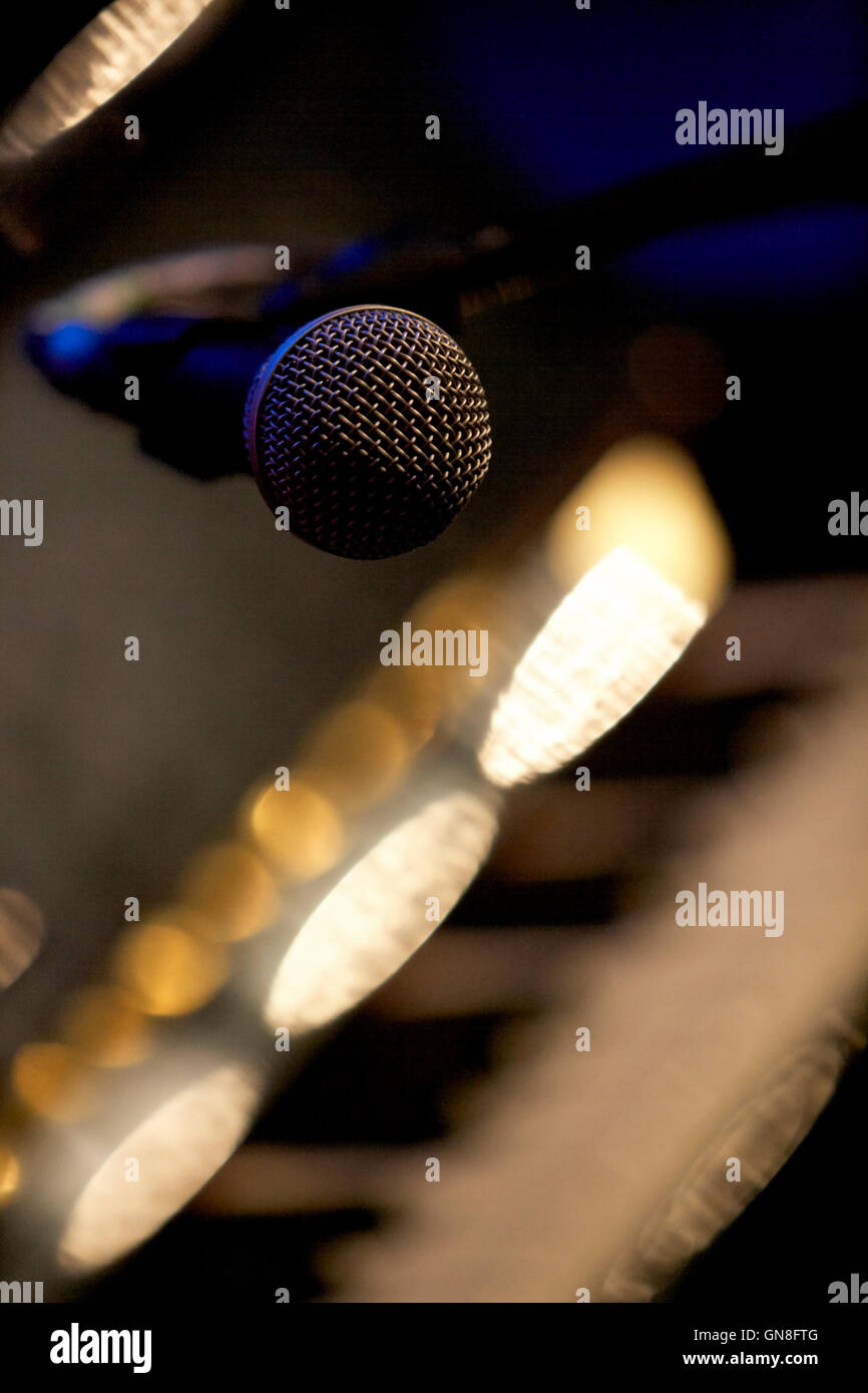 microphone on boom stand wired on stage in a theatre - Stock Image