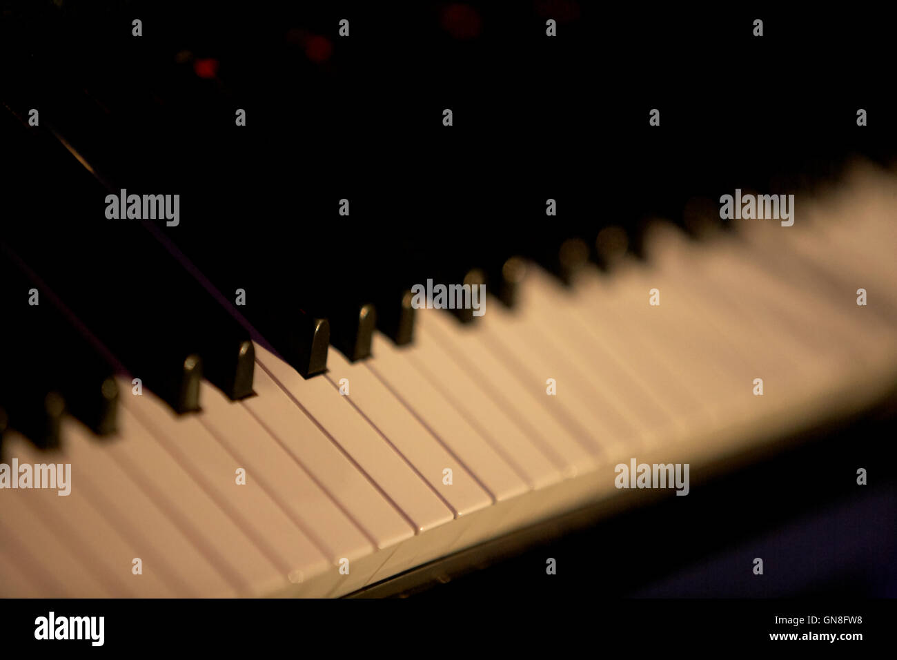 shallow depth of field on dimly lit piano keyboard - Stock Image