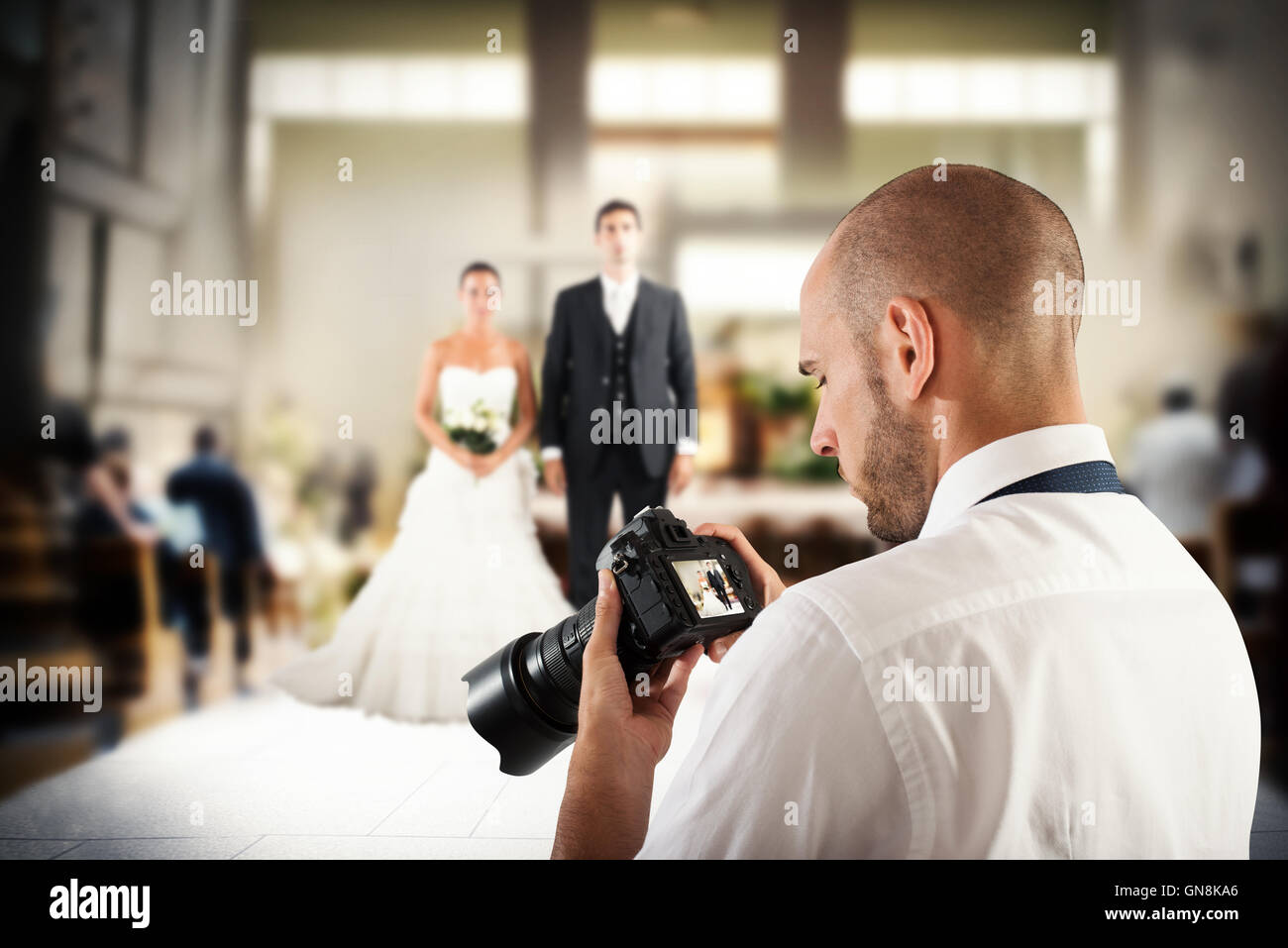 Professional photographer in a wedding - Stock Image