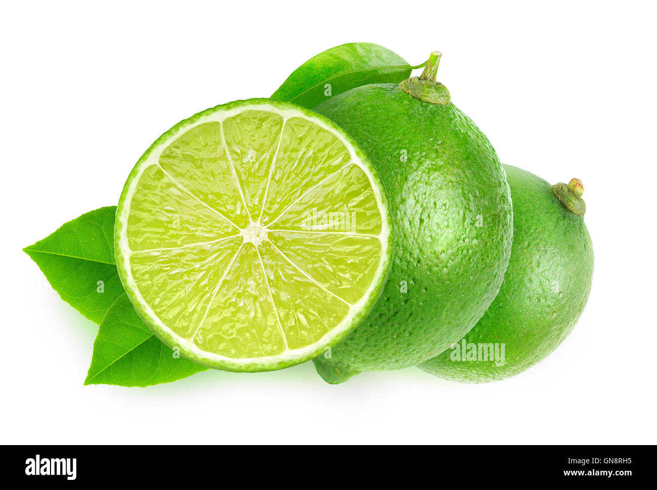 Isolated limes. Cut lime fruits isolated on white background with clipping path - Stock Image