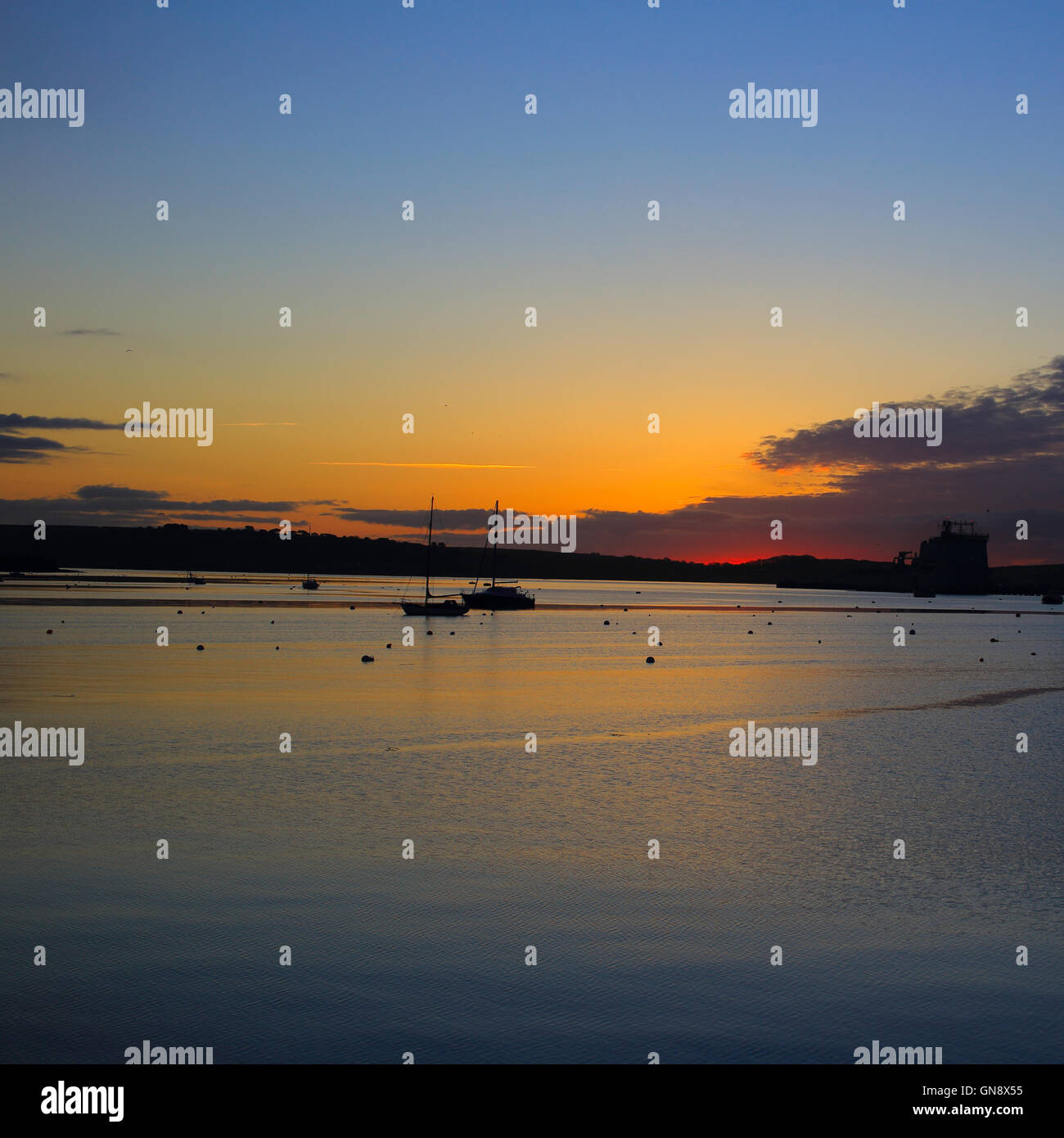 Sunrise over the Carrick Roads at high tide, Falmouth, Cornwall, England, UK. - Stock Image