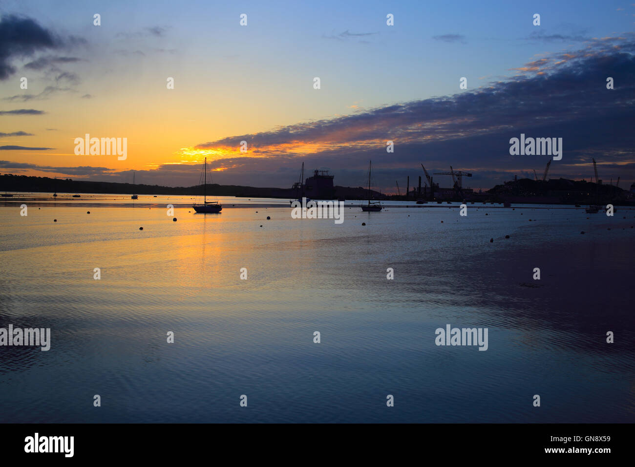 Sunrise over the Carrick Roads at high tide, Falmouth, Cornwall, England, UK. Stock Photo