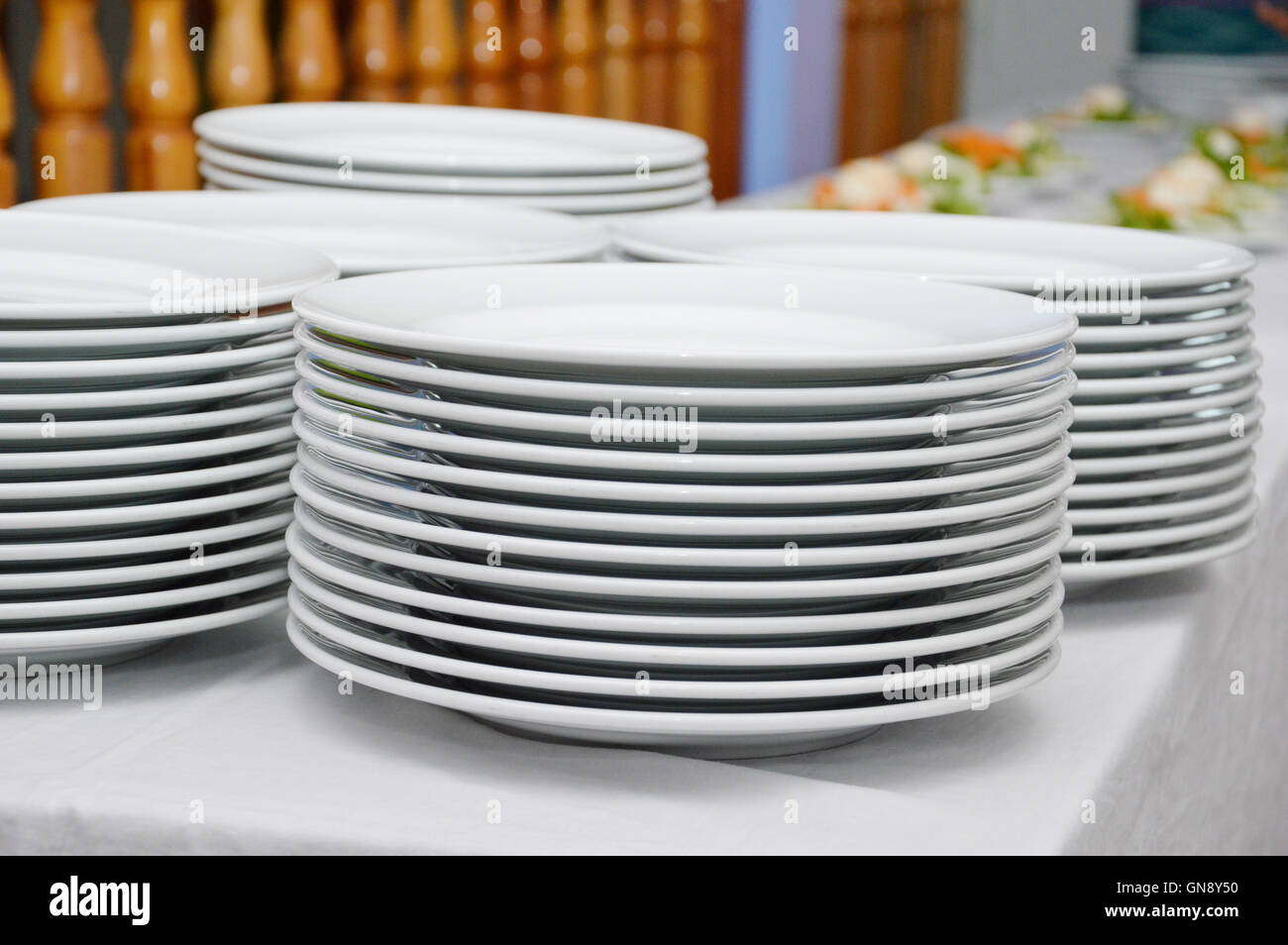 saucers piled ready to serve meals in a gala diner. - Stock Image
