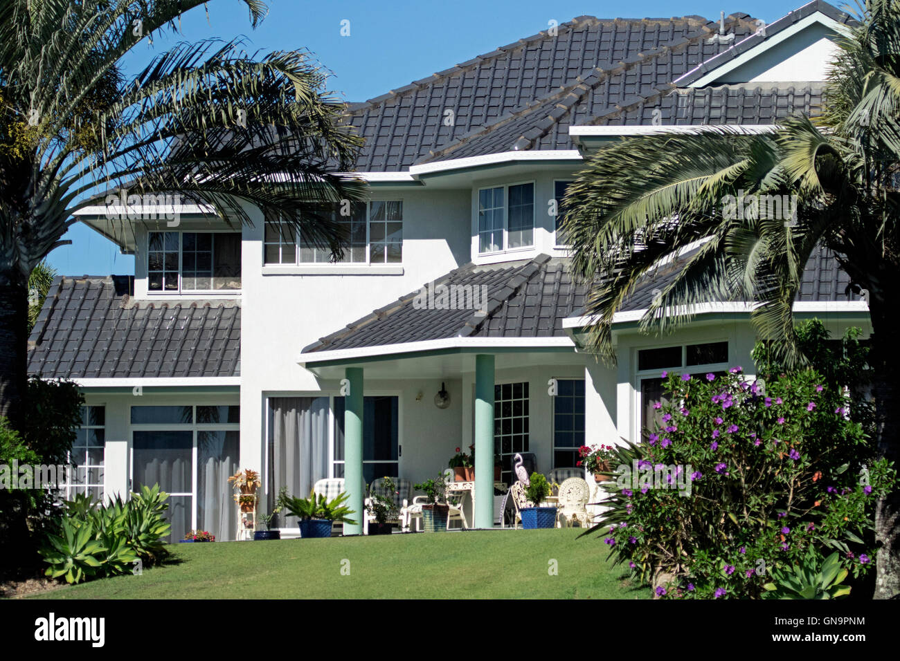 Modern luxurious two story house with black tiled roof for Roof height of 2 story house