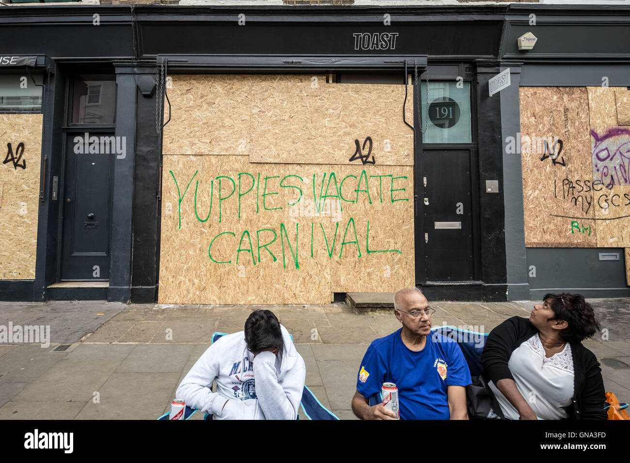 London, UK. 29th August 2016. Boarded-up local shops and businesses seen during Notting Hill Carnival 2016. Angry - Stock Image