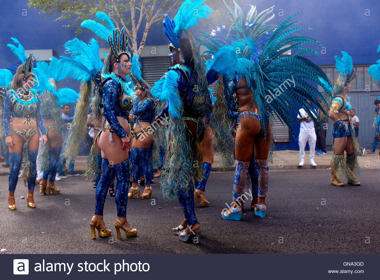 Women wearing exotic costumes with plumage as they prepare for the 50th Notting Hill Carnival, London, August 29 - Stock Image
