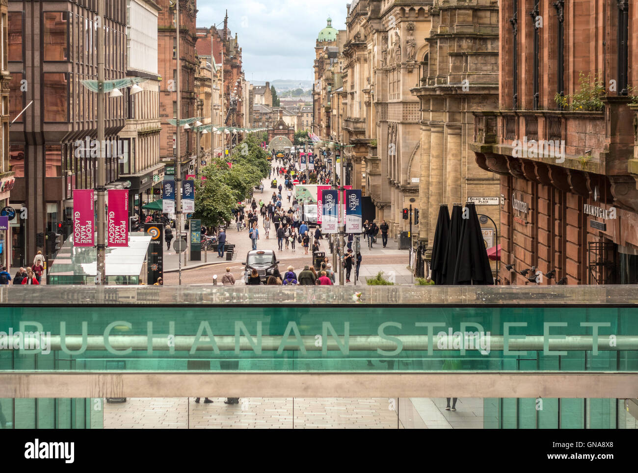 Glasgow Buchanan Street a popular street for shopping. Entrance to the underground station. - Stock Image