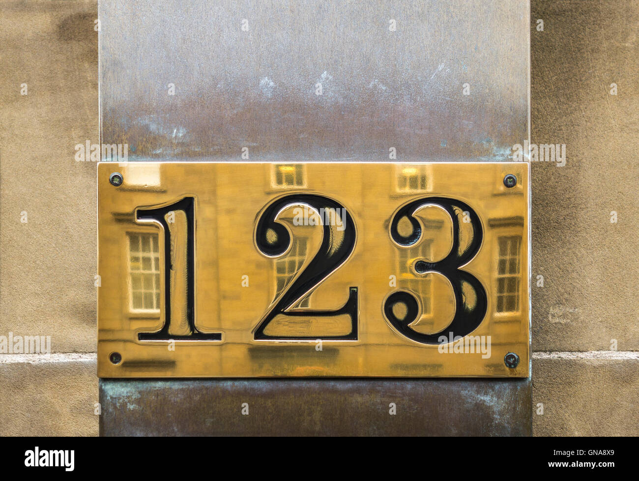 123 sign. Brass house number sign 123. - Stock Image