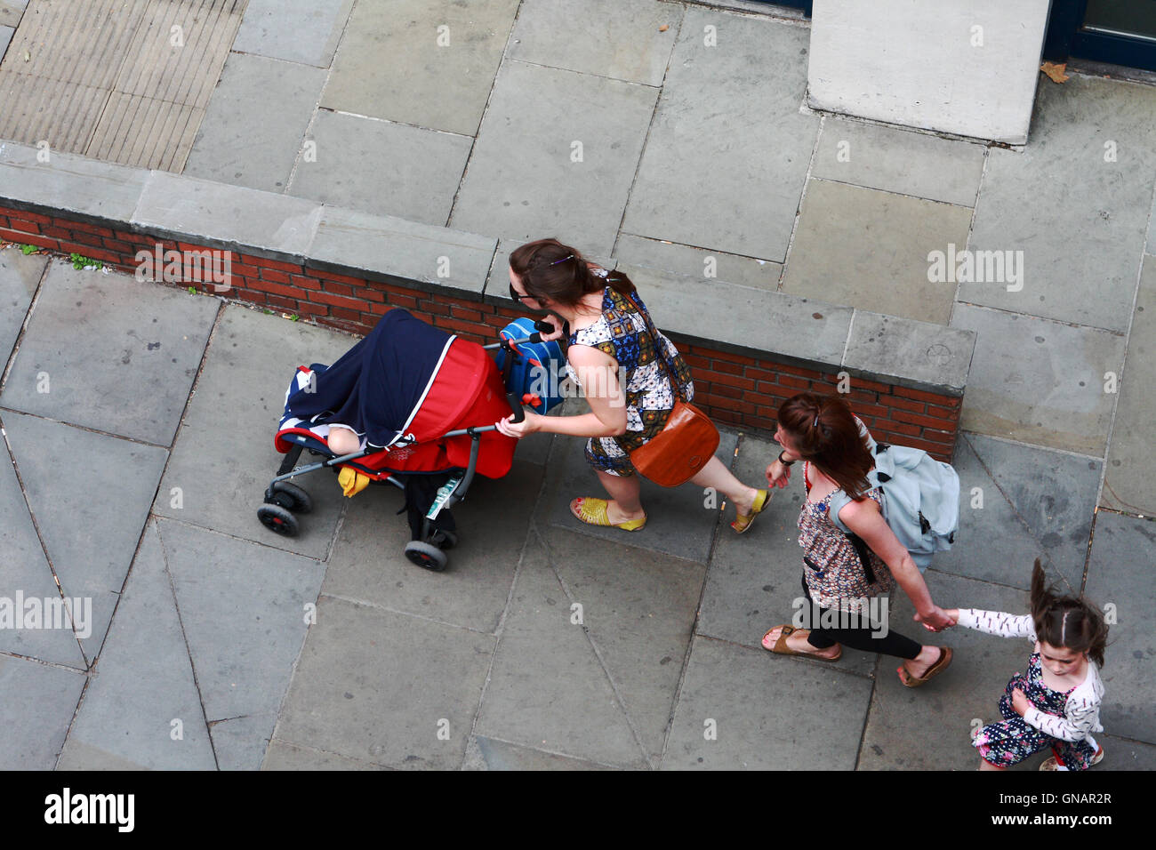 Looking down on people walking along Northumberland Avenue towards Trafalgar Square in London, England. Stock Photo