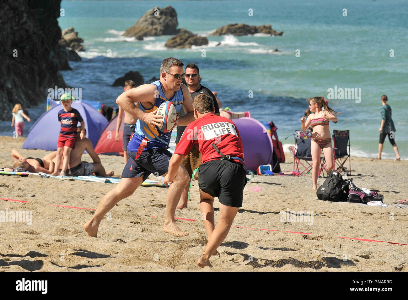 The annual Lusty Glaze Beach Tag Rugby tournament in Newquay, Cornwall. - Stock Image
