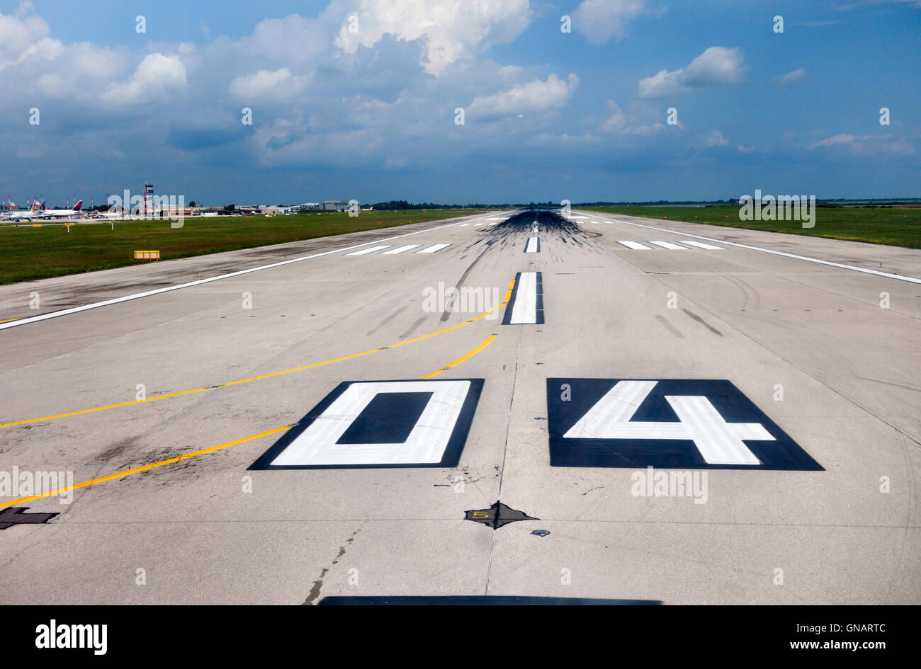 View along a runway from an aircraft about to take off (Venice Marco Polo Airport, Italy) - Stock Image