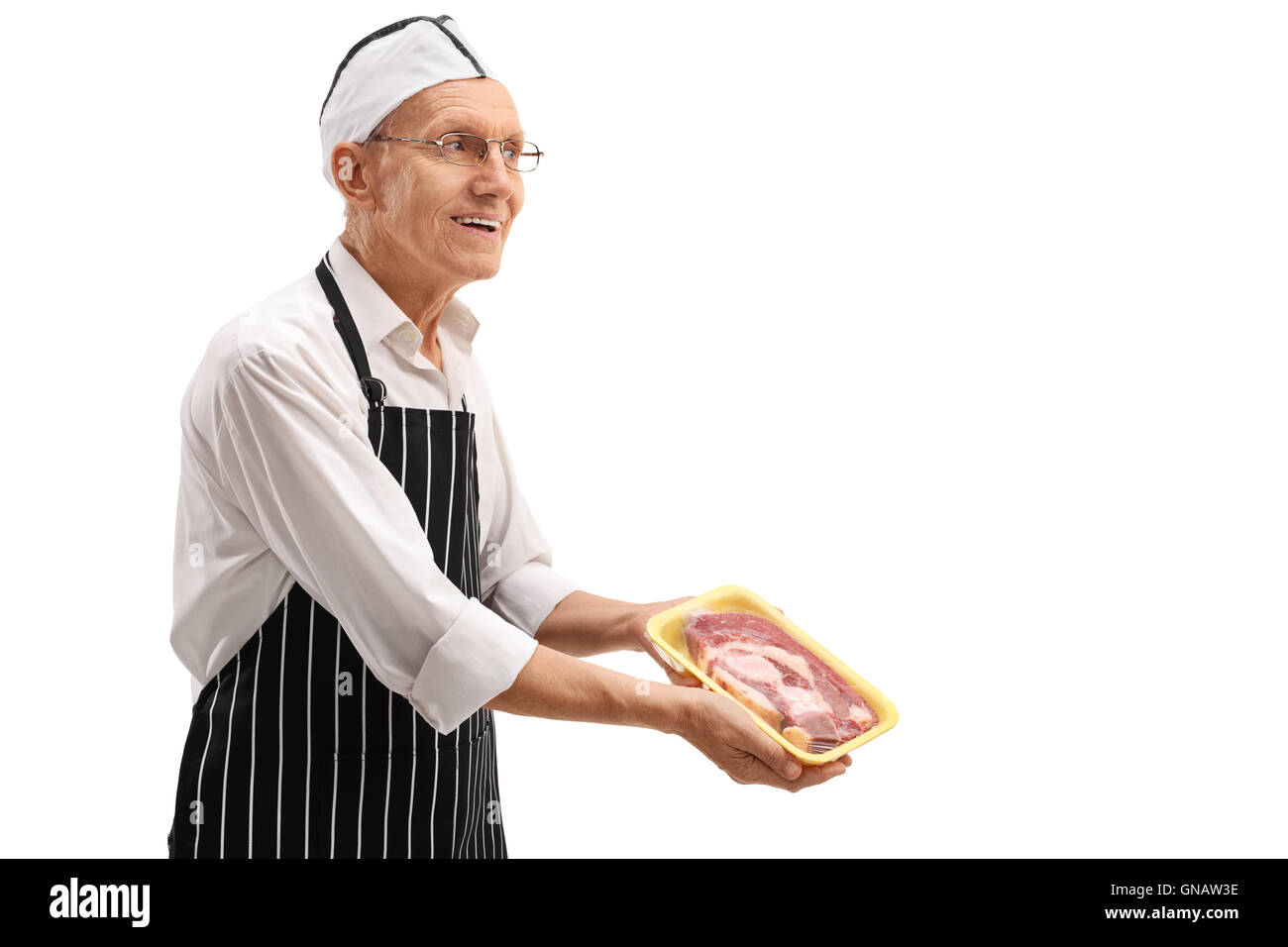 Elderly butcher showing packed meat isolated on white background - Stock Image