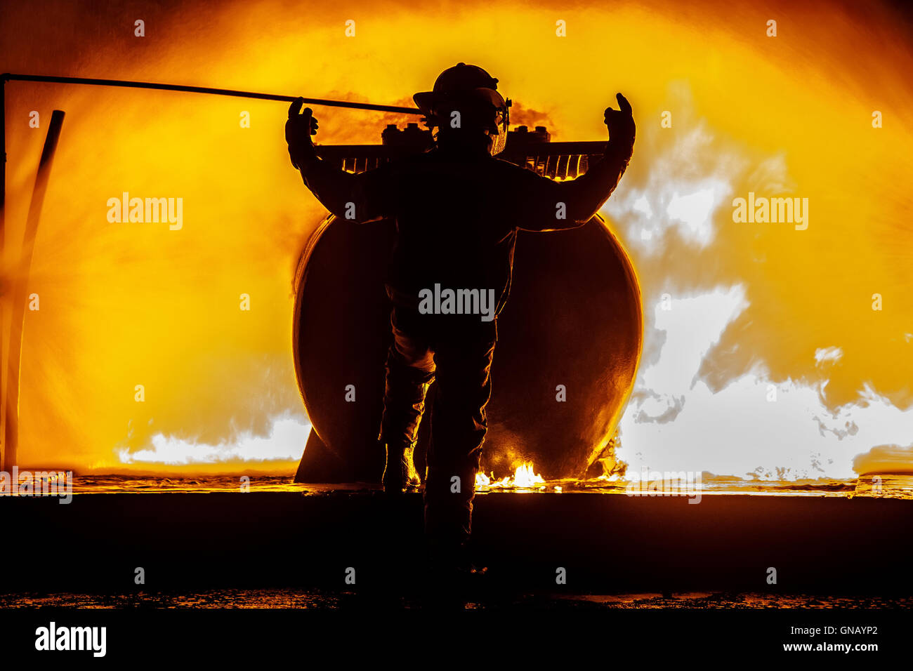 Firechief standing in front of fire - Stock Image