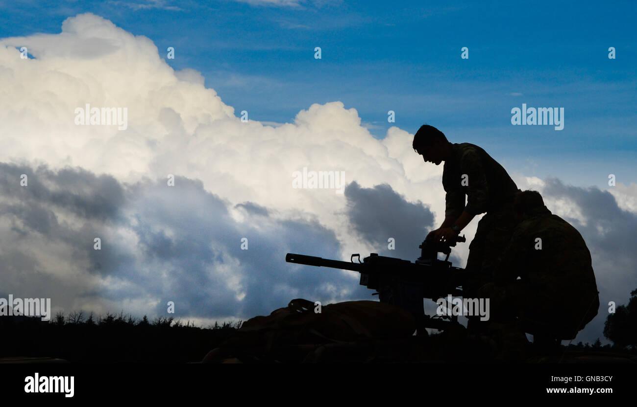 A paratrooper of the British Army Parachute Regiment prepares a 40mm grenade machine gun - Stock Image