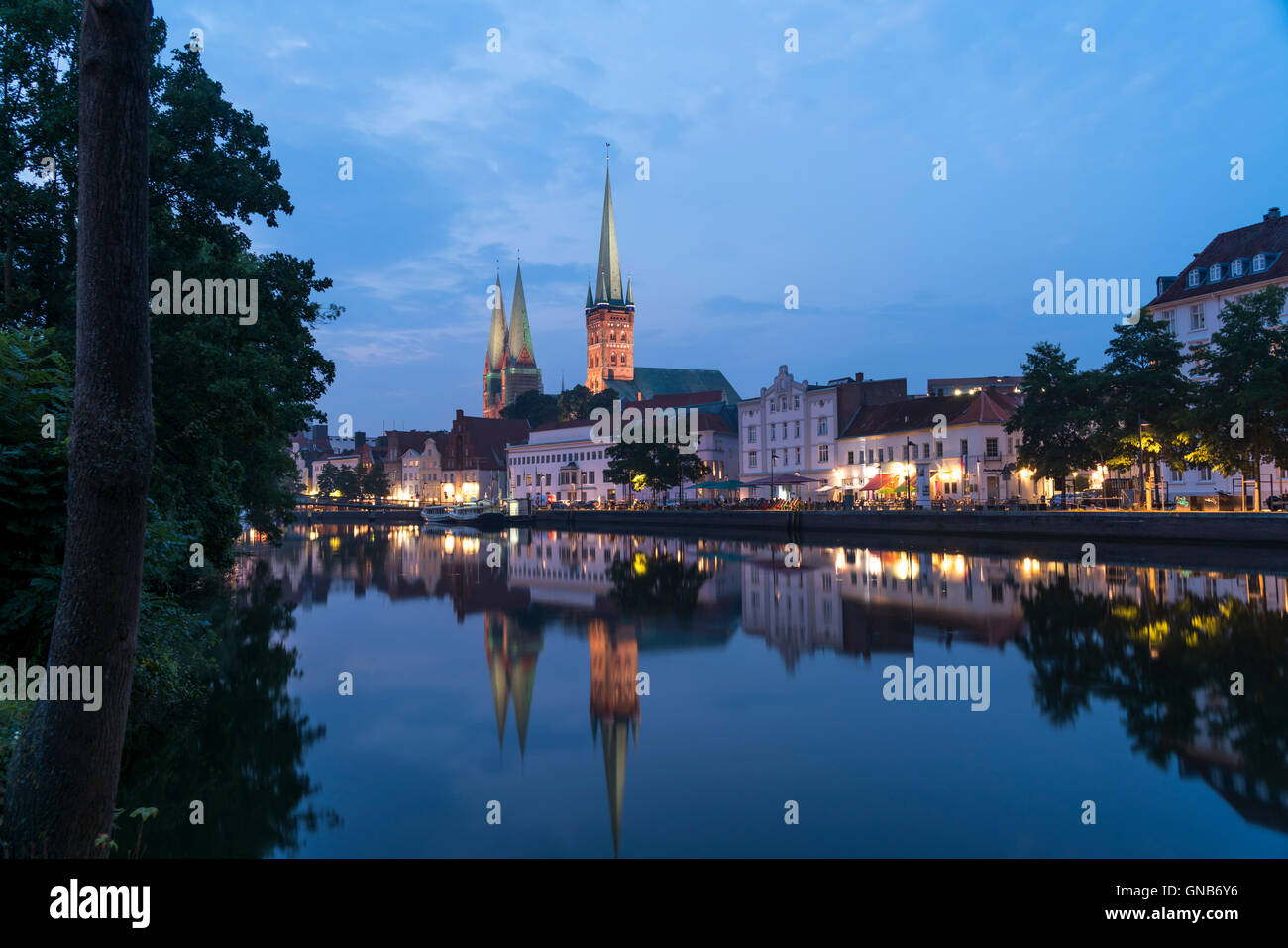 old town and river Trave at dusk, Lübeck, Schleswig-Holstein, Germany - Stock Image