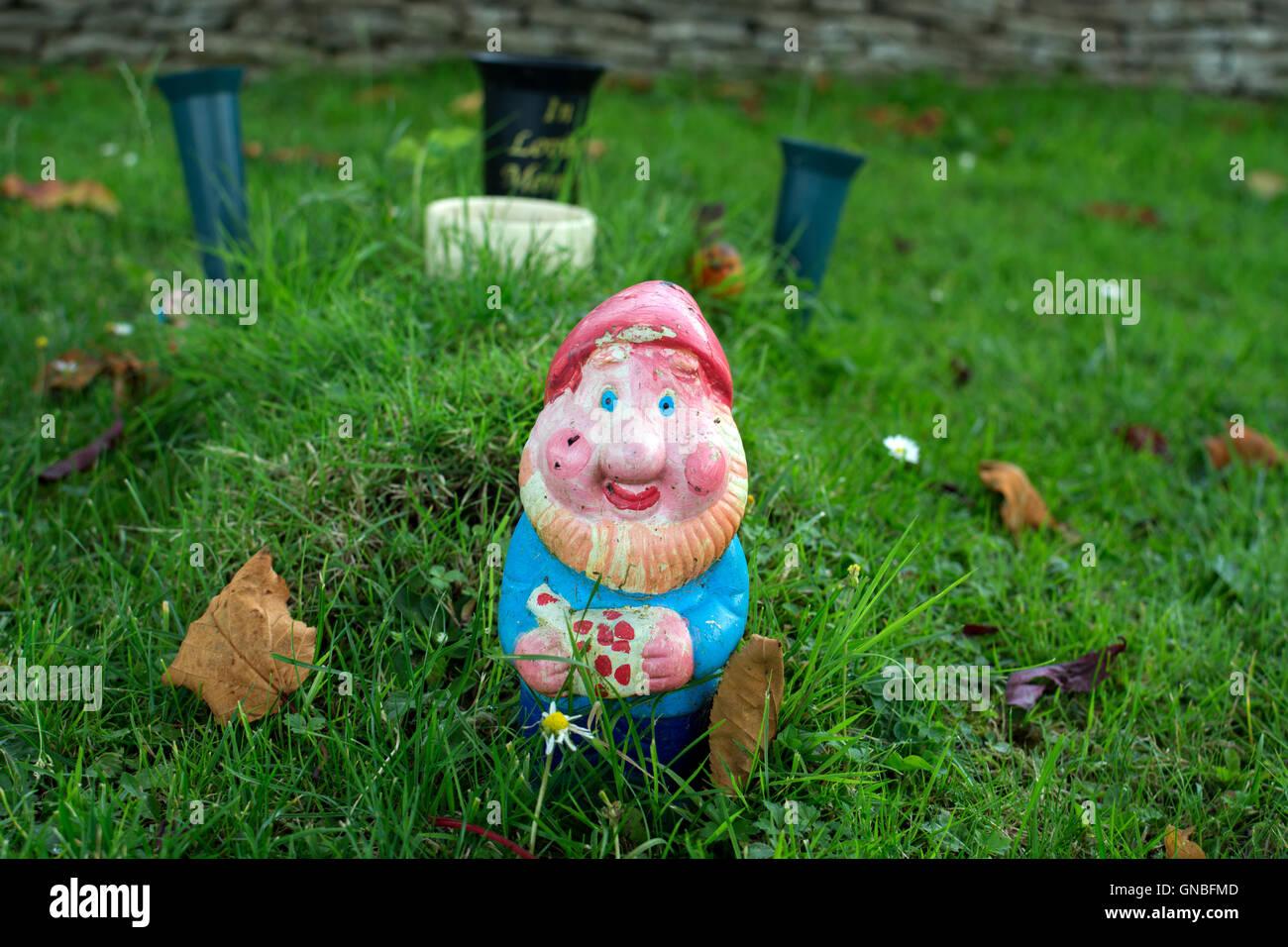 A garden gnome in a cemetery, UK Stock Photo