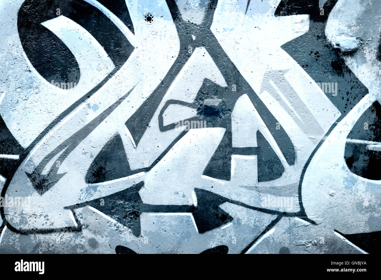 Graffiti over old dirty wall urban hip hop background gray text