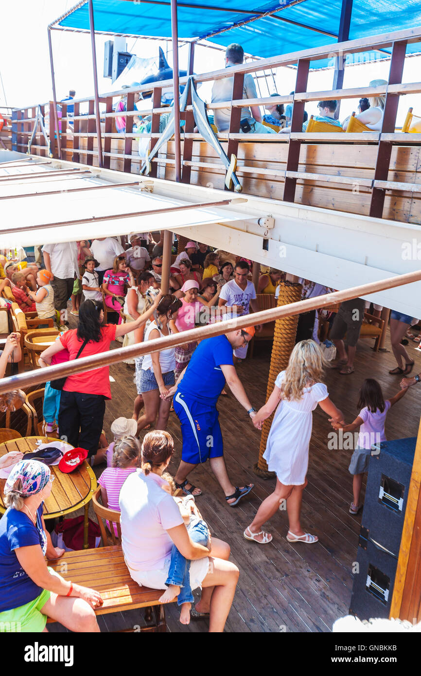 OURANOPOLIS, GREECE - JUNE 05, 2009: Tourists dancing Sirtaki at deck of touristic cruise ship Stock Photo