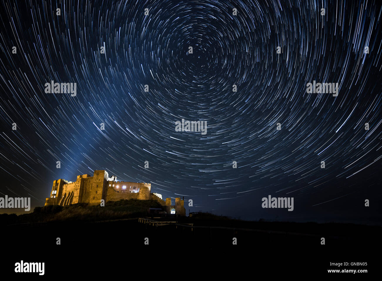 A Night Sky full of Stars at Bamburgh Castle in Northumberland, UK - Stock Image