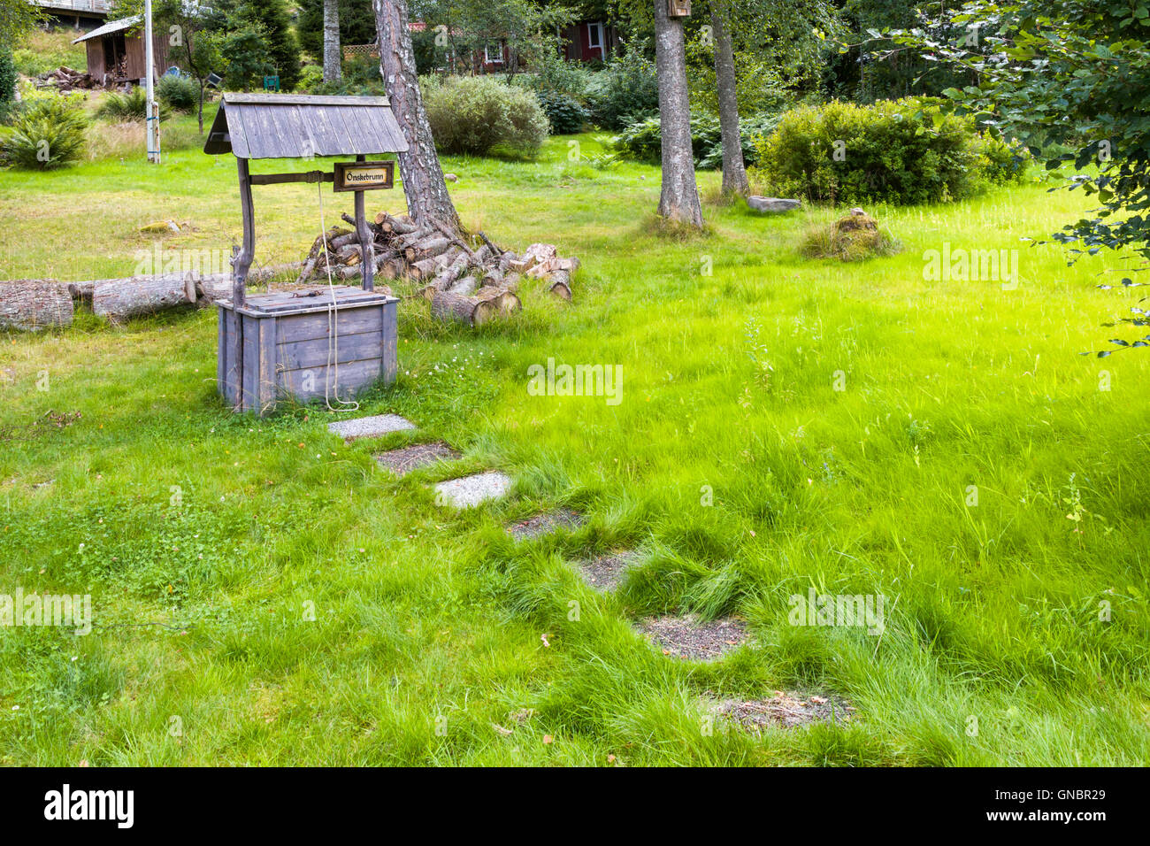 Path to garden wishing well  Model Release: No.  Property Release: No - Stock Image