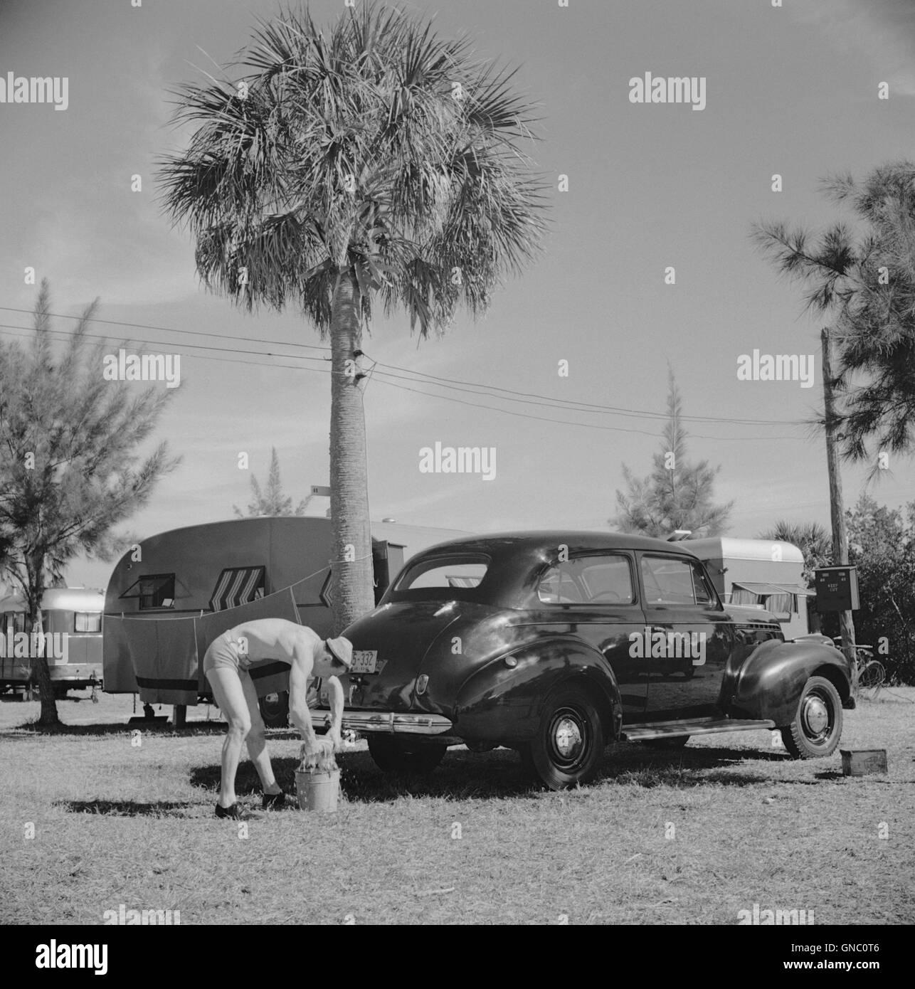 Man Washing Car at Trailer Park, Sarasota, Florida, USA, Marion Post Wolcott for Farm Security Administration, January Stock Photo
